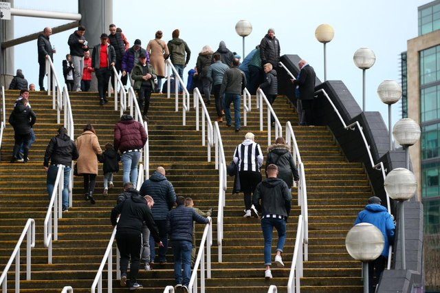 Newcastle United fans arrive at St James's Park for a game in 2019.