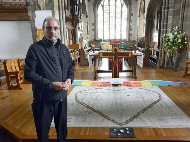 Canon Provost of Sunderland Minster Stuart Bain with a previous Covid 19 victims memorial
