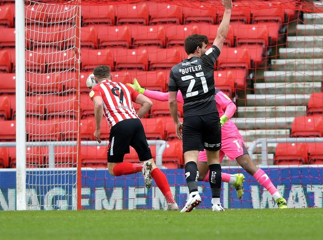 Charlie Wyke scores against Doncaster in February.