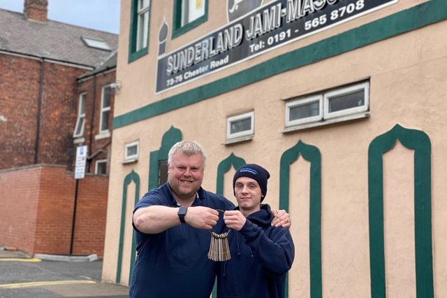 Locksmith Paul Fletcher with his son and colleague Layton outside the Chester Road mosque where he donated his services for free.