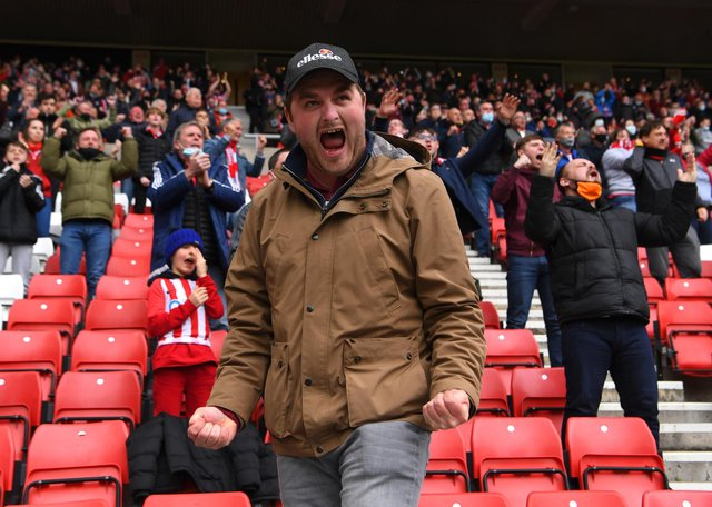 SUNDERLAND, ENGLAND - MAY 22: A Sunderland fan celebrates after the first Sunderland goal during the Sky Bet League One Play-off Semi Final 2nd Leg match between Sunderland and Lincoln City  at Stadium of Light on May 22, 2021 in Sunderland, England. (Photo by Stu Forster/Getty Images)