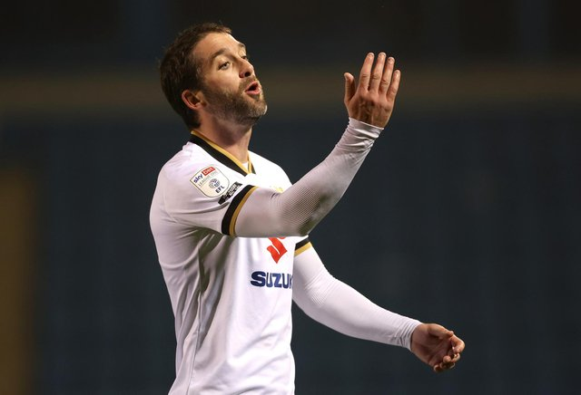 GILLINGHAM, ENGLAND - MARCH 02: Will Grigg of Milton Keynes Dons reacts during the Sky Bet League One match between Gillingham and Milton Keynes Dons at MEMS Priestfield Stadium on March 02, 2021 in Gillingham, England. Sporting stadiums around the UK remain under strict restrictions due to the Coronavirus Pandemic as Government social distancing laws prohibit fans inside venues resulting in games being played behind closed doors. (Photo by James Chance/Getty Images)