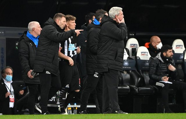 Matt Ritchie is given instructions by Graeme Jones before coming on against Wolverhampton Wanderers as Steve Bruce stands on the touchline.
