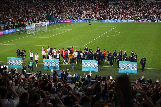 England players celebrate with the fans after their semi-final win over Denmark at Wembley.