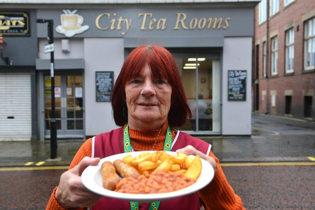 City Tea Rooms are offering free meals for children during half term. Staff member Margaret Corbett outside the cafe.