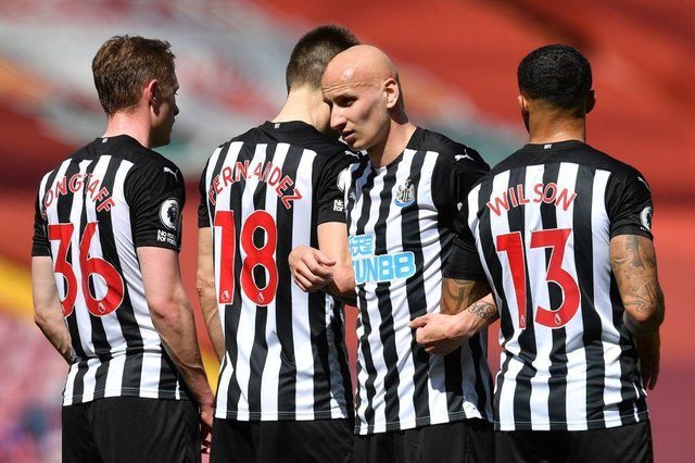 Jonjo Shelvey lines up a wall at Anfield.