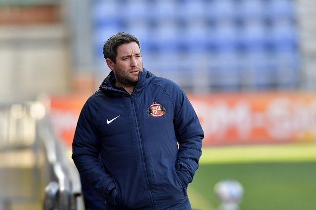 Lee Johnson watches on at the DW Stadium