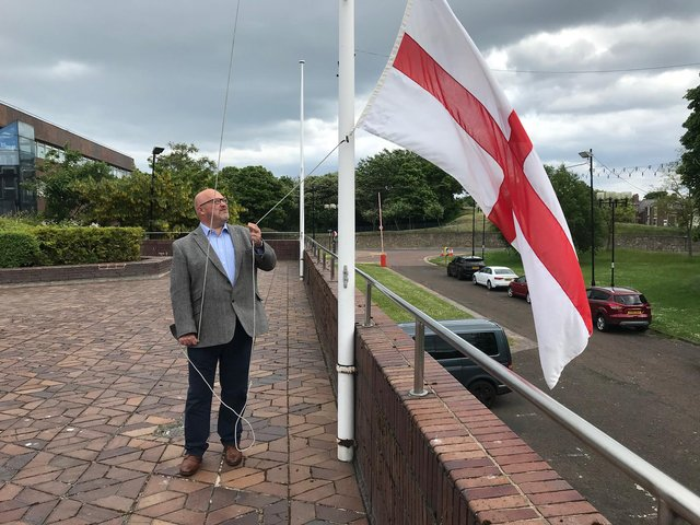 Leader of City Council raises the Cross of St George