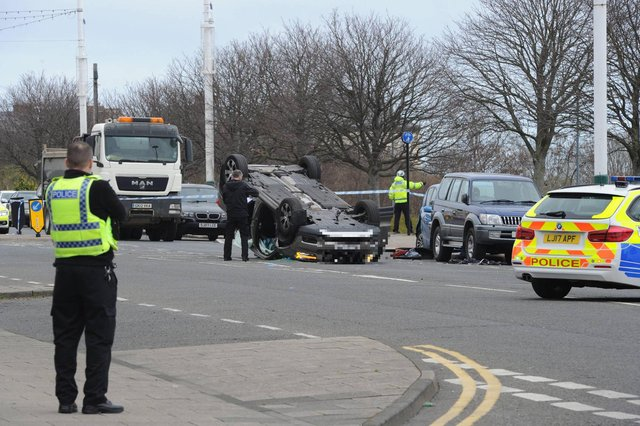 Police cordon off the area where a car lies overturned near The Wolsley pub in Sunderland following an accident this morning leading to a man being taken to hospital with serious injuries.