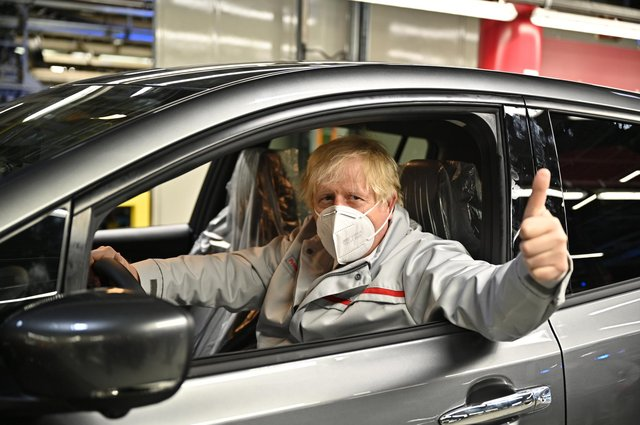 SUNDERLAND, UNITED KINGDOM - JULY 1:  British Prime Minister Boris Johnson visits the Nissan Motor Co. plant on July 1, 2021 in Sunderland, England. Nissan announces a huge increase in their battery production business with plans for a gigaplant at Sunderland, bringing thousands of jobs to the North East. The UK Government has committed to phasing out the sale of new petrol and diesel cars by 2030 which will see an increase in the sales of electric vehicles.  (Photo by Jeff J Mitchell/Getty Images)