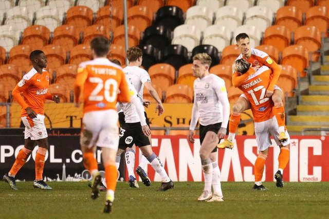 Jerry Yates of Blackpool celebrates with Kenny Dougall after scoring their side's second goal from the penalty spot against Peterborough.