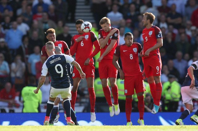 Scotland's Leigh Griffiths scores a free kick during their last game against England; a 2-2 draw at Hampden Park in 2017. PA image.
