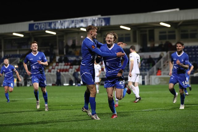Luke Armstrong of Hartlepool United celebrates with Lewis Cass.