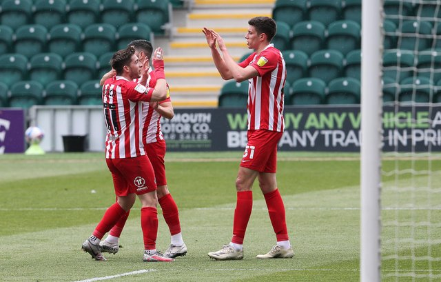 Ross Stewart celebrates his opening goal at Home Park