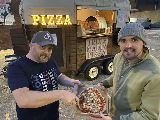 Jed Wade with his son Sam with a Pizza they have just cooked. Picture by FRANK REID
