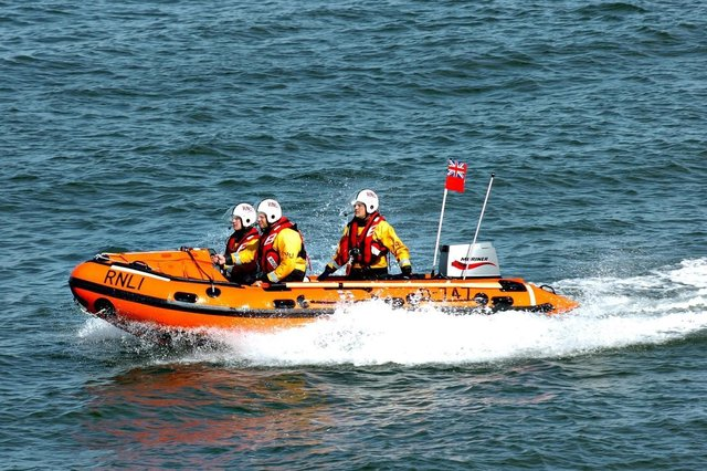 Sunderland RNLI volunteers were called out to rescue three teenagers who had become cut off by the tide in Roker.