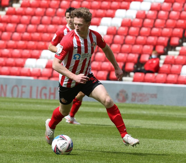 SUNDERLAND, ENGLAND - MAY 09: Denver Hume of Sunderland in action during the Sky Bet League One match between Sunderland and Northampton Town at Stadium of Light on May 09, 2021 in Sunderland, England. (Photo by Pete Norton/Getty Images)