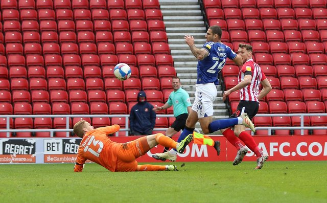 Ben Amos makes a strong early save from Charlie Wyke