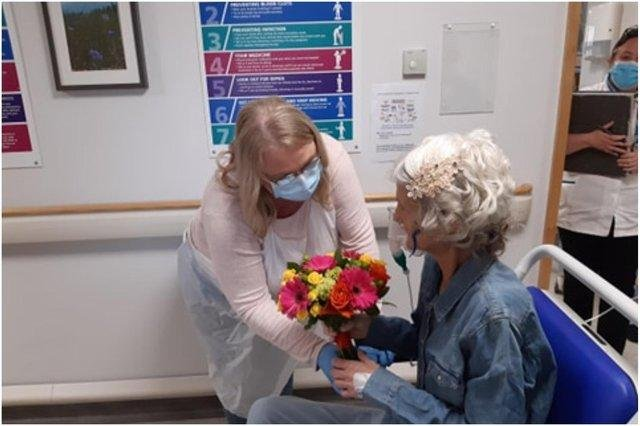 Niece Leigh Brown giving flowers to Gail ahead of the wedding ceremony last Friday, May 21.