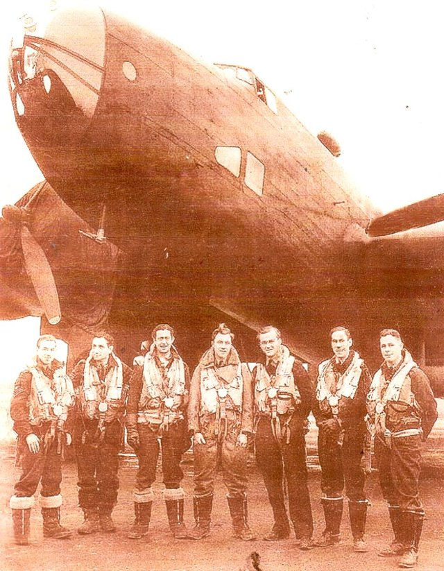 Mr Vandervelde (second from left) pictured with a Halifax bomber during his Second World War service.
