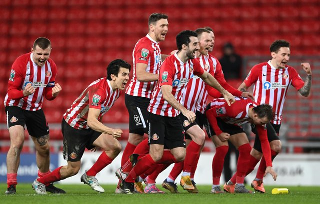 Sunderland players celebrate the penalty shoot-out victory after the Papa John's Trophy semi-final match between Sunderland and Lincoln City.