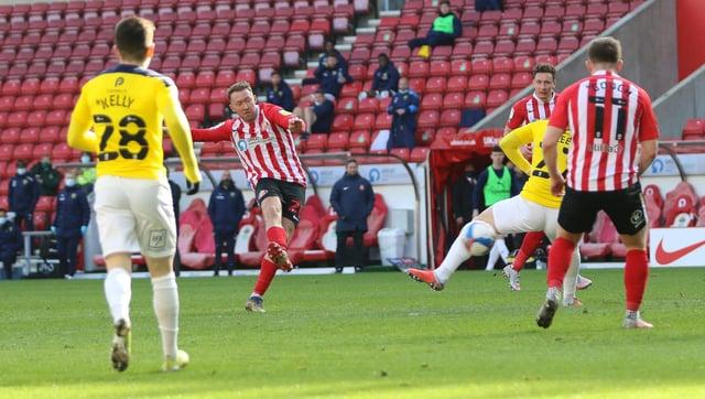 Aiden McGeady scores against Oxford.