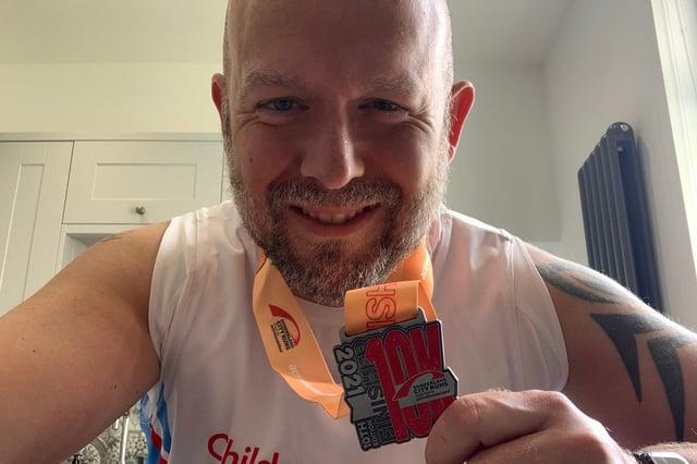 Chris Johnson with his Sunderland 10K medal.