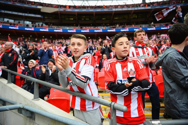 Young Sunderland fans look on prior to the Capital One Cup final between Manchester City and Sunderland at Wembley Stadium on March 2, 2014.