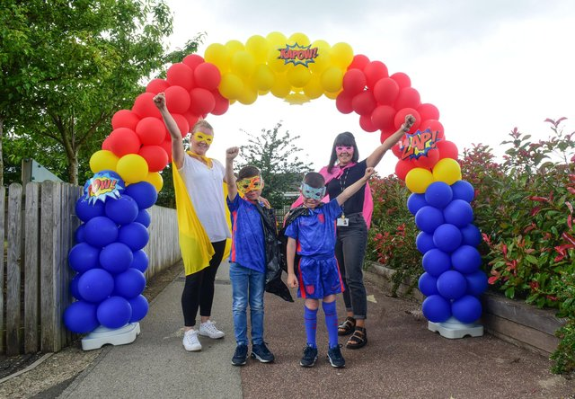 Deputy Head Teachers Amy Ball (left) and Laura Park (right) with Oliver's brothers Oscar and Owen.
