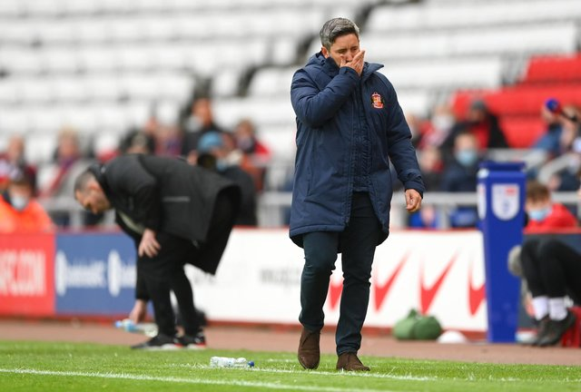 SUNDERLAND, ENGLAND - MAY 22: Sunderland manager Lee Johnson reacts dejectedly during the Sky Bet League One Play-off Semi Final 2nd Leg match between Sunderland and Lincoln City  at Stadium of Light on May 22, 2021 in Sunderland, England. (Photo by Stu Forster/Getty Images)
