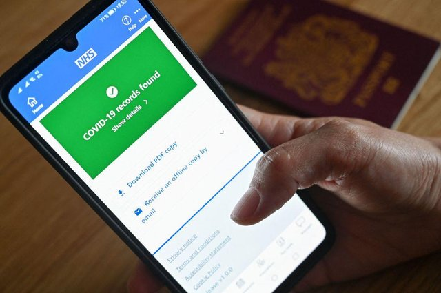 An illustration picture shows a smartphone screen displaying a Covid-19 vaccine record on the NHS app. Picture: Justin Tallis/AFP via Getty Images.