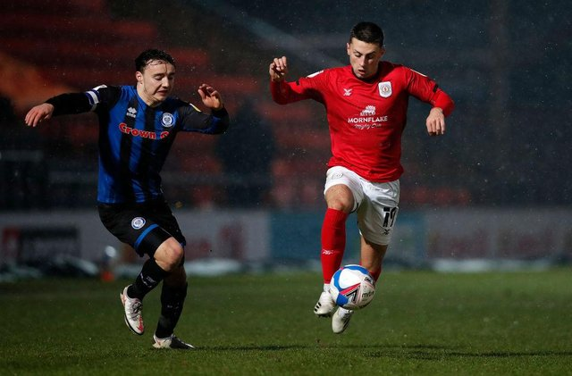 Owen Dale of Crewe Alexandra moves away from Ollie Rathbone of Rochdale.