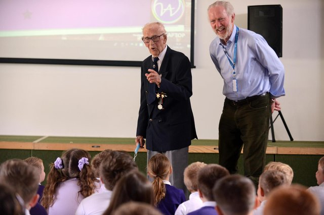 Hasting Hill Academy assembly hosted by 101 year old veteran Len Gibson with Daft as a Brush founder Brian Burnie.