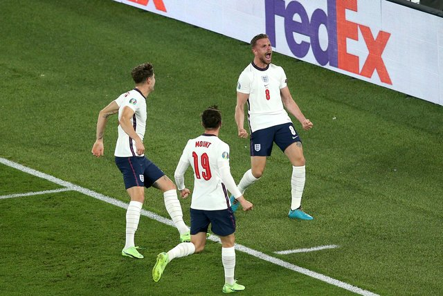 England's Jordan Henderson celebrates scoring their side's fourth goal of the game during the UEFA Euro 2020 Quarter Final match at the Stadio Olimpico, Rome. Picture date: Saturday July 3, 2021.