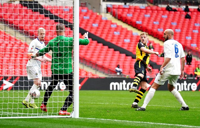 Hebburn Town's Thomas Potter (centre) shoots towards goal during the Buildbase FA Vase 2019/20 Final at Wembley Stadium, London. PA.