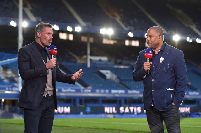 Jamie Carragher speaks with John Barnes for Sky Sports after the Premier League match between Everton FC and Liverpool FC at Goodison Park on June 21, 2020 in Liverpool, England. Football Stadiums around Europe remain empty due to the Coronavirus Pandemic as Government social distancing laws prohibit fans inside venues resulting in all fixtures being played behind closed doors.