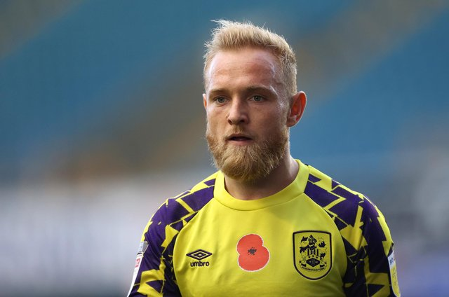 LONDON, ENGLAND - OCTOBER 31: Alex Pritchard of Huddersfield Town looks on during the Sky Bet Championship match between Millwall and Huddersfield Town at The Den on October 31, 2020 in London, England. (Photo by James Chance/Getty Images)