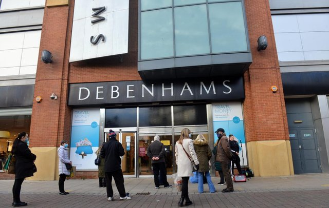 Shoppers wait to get into Sunderland's Debenhams store, which will close on Saturday, May 8.