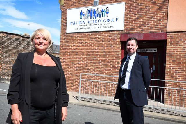 Karen Noble, manager at Pallion Action Group, with Newcastle Building Society's David Pearson.