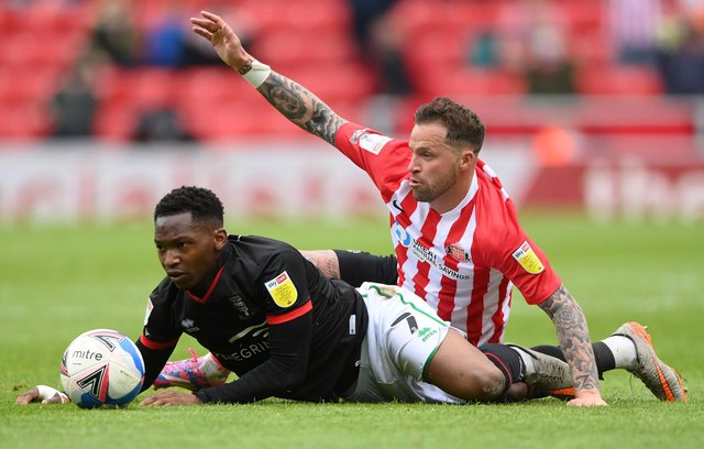 SUNDERLAND, ENGLAND - MAY 22: Sunderland player Chris Maguire (r) challenges Tayo Edun of Lincoln during the Sky Bet League One Play-off Semi Final 2nd Leg match between Sunderland and Lincoln City  at Stadium of Light on May 22, 2021 in Sunderland, England. (Photo by Stu Forster/Getty Images)
