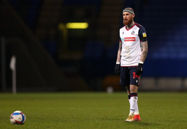 BOLTON, ENGLAND - MARCH 09: Marcus Maddison of Bolton Wanderers prepares to take a free kick during the Sky Bet League Two match between Bolton Wanderers and Cambridge United at University of Bolton Stadium on March 09, 2021 in Bolton, England. Sporting stadiums around the UK remain under strict restrictions due to the Coronavirus Pandemic as Government social distancing laws prohibit fans inside venues resulting in games being played behind closed doors. (Photo by Charlotte Tattersall/Getty Images)