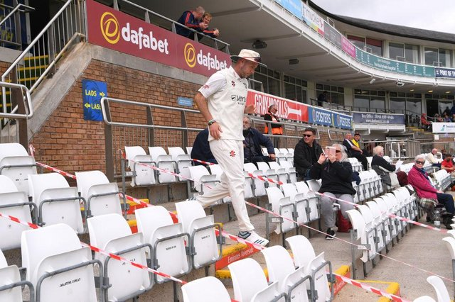 Durham bowler Chris Rushworth makes his way down the pavilion steps to the pitch past spectators for the first time at the Riverside this season before day one of the LV= Insurance County Championship match between Durham and Essex at Emirates Riverside.