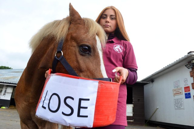 Penshaw Equestrian Centre's Ezmie Stanton with Yellow the psychic pony who predicts a lose result ahead of the England V Italy Euro2020 final.