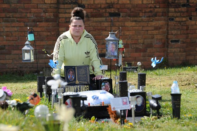 Katrina Keegan pictured at her son's grave