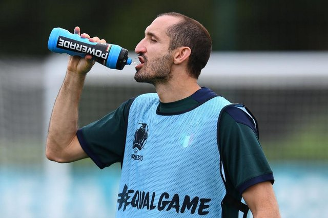 Giorgio Chiellini takes a drink during the training session ahead of the Euro 2020 Final match between Italy and England.