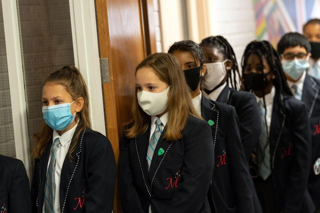 With children being sent home from school due to cases of Coronavirus, what should parents do if their children are sent home because somebody else has tested positive? (Photo by OLI SCARFF/AFP via Getty Images)