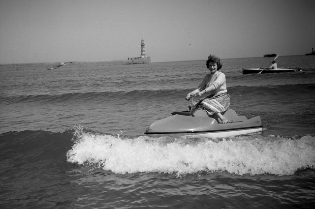 Stella Cleghorn has fun on a water scooter at Roker in 1957.