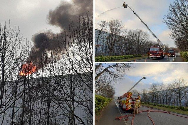 Firefighters at the scene of a second fire at the Komatsu factory