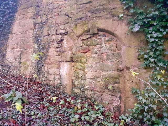 The ancient doorway was crudely bricked up in the late 1940s.