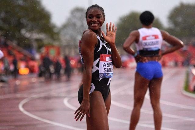 Britain's Dina Asher-Smith celebrates after winning the women's 100m final during the Diamond League athletics meeting at Gateshead International Stadium.